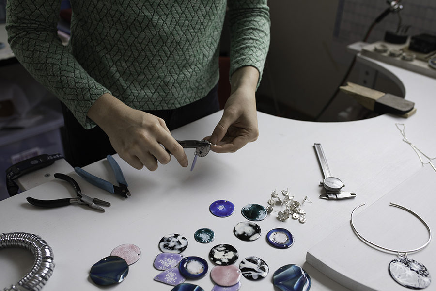 Ada Hodgson creating her handmade pieces in her studio